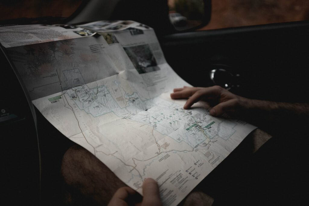 crop man with map in automobile
